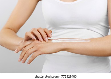 Hand Skin Care. Close Up Of Female Hands Applying Cream, Lotion. Beautiful Woman Hands With Red Manicure. Nails Applying Cosmetic Hand Cream On Soft Silky Healthy Skin. Beauty And Body Care Concept
