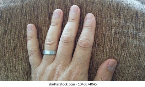 Hand skin texture with grey ring