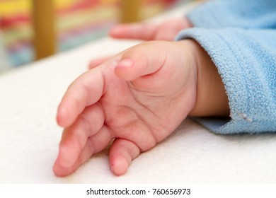 The hand of a small child.