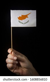 Hand with small flag of state of Cyprus
