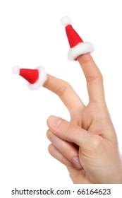 A hand with small Santa's caps on fingers isolated on white