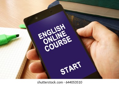 Hand with smartphone and English online course.