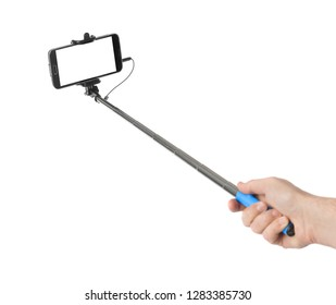 Hand and smartphone with selfie stick isolated on white background