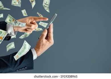 A hand from a smartphone transfers money and dollars fly out. Online cash transactions, mobile payments using a smartphone. Concept Financial growth, passive income, online business, dividends