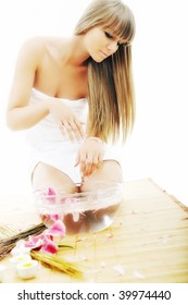 hand spa and beauty treatment with aroma and flowers in water