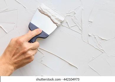 Hand with a spatula