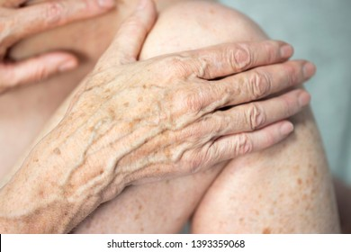 Hand with spots of old age