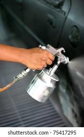 Hand with spray paint gun