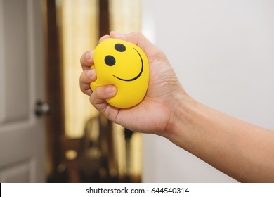 Hand squeeze yellow stress ball, anger management, positive thinking concepts