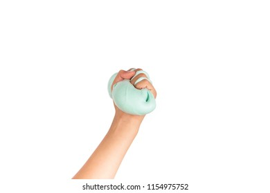 Hand squeezing a slime toy. Isolated on white.