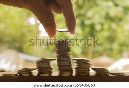hand stacking of coins concept idea for save money and business growth plan.