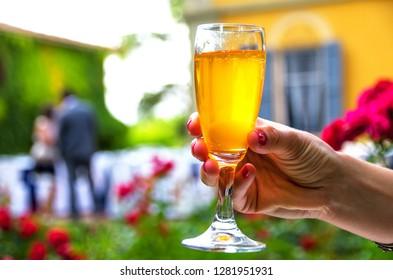hand stem glass background woman drinking alcohol wine aperitif .