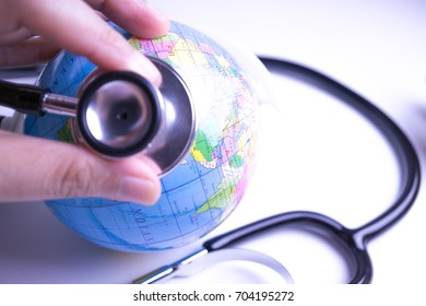 hand with stethoscope auscultating world
