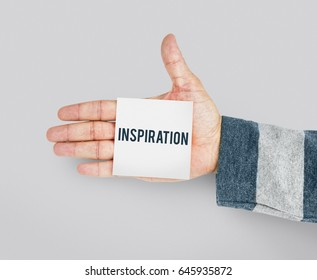 Hand with Sticky Note Showing Inspiration Word