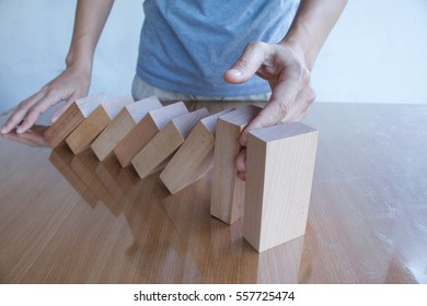 Hand stop dominoes continuous toppled.