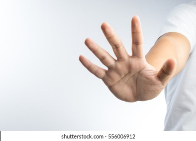 hand with stop gesture on white background