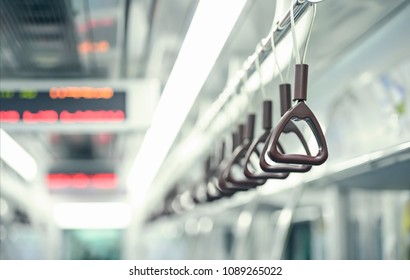 hand straps on subway. Hand grip strap in public transportation. Selective focus of perspective handle of subway for safety. business man commutes with hand straps on the Seoul Metro every day.