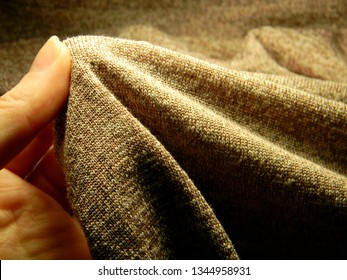 Hand stretch peach colored synthetic stretch fabric. Hosiery,