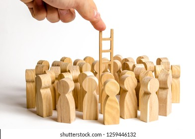 The hand stretches the ladder to a group of human figures. career ladder. Promotion at work, business, self-development, leadership skills, social elevator, social rating system. minimalism, anomaly