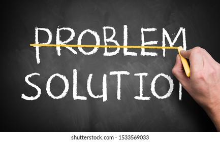 """hand is striking the word """"problem"""" leaving a second option """"solution"""" on a blackboard"""