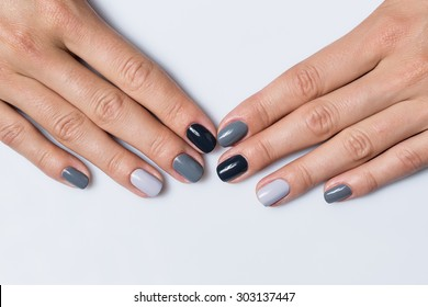 Hand with a stylish gray manicure isolated on white background