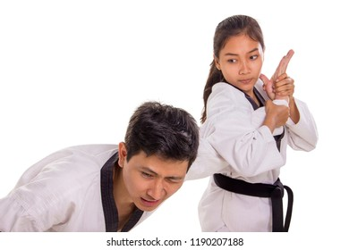 Hand submission technique practiced by a female martial artist to her male opponent. Isolated on white background