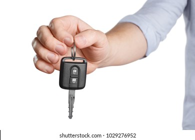 Hand suggesting car key on white background