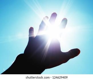 Hand to sun. Element of design.