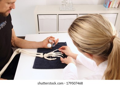 Hand surgeon supports patient with balls