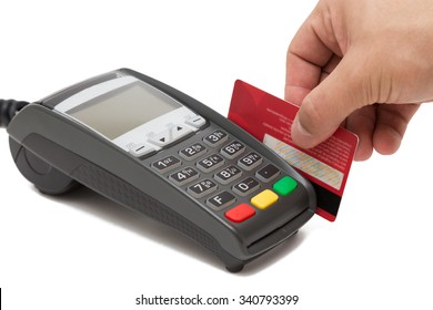 Hand swipe red credit through payment terminal