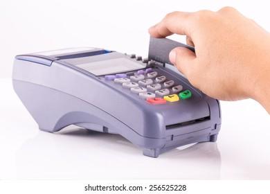 Hand Swiping Credit Card On Credit Card Machine