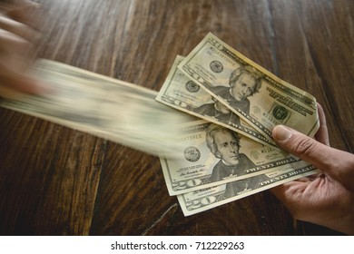 Hand takes one hundred banknote