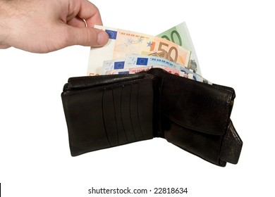 Hand taking a euro bill out of an old black leather wallet full of euro bills (isolated on white)