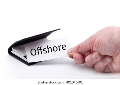 Hand taking a paper card with the word OFFSHORE from a pile of paper cards in the business card holder (on white, as an offshore concept)