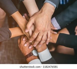 Hand of team stack hands support teamwork