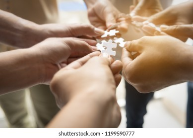 Hand teamwork together pick puzzle piece  business jigsaw,agree to coporation success in business.