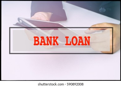 Hand and text BANK LOAN with vintage background. Technology concept.