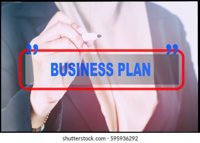 """Hand and text  """"BUSINESS PLAN"""" with vintage background. Technology concept."""