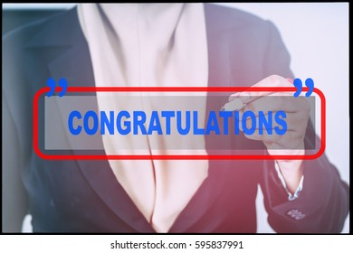 """Hand and text  """"CONGRATULATIONS"""" with vintage background. Technology concept."""