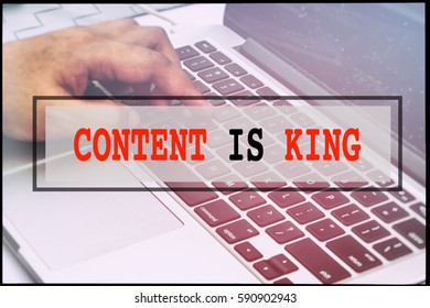Hand and text CONTENT IS KING with vintage background. Technology concept.