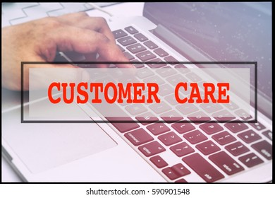 Hand and text CUSTOMER CARE with vintage background. Technology concept.