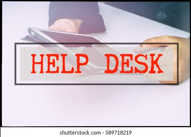Hand and text HELP DESK with vintage background. Technology concept.