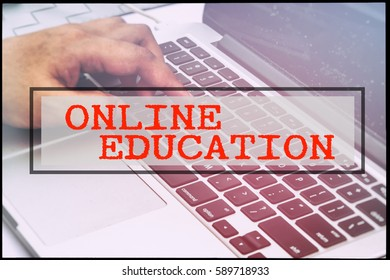 Hand and text ONLINE EDUCATION with vintage background. Technology concept.