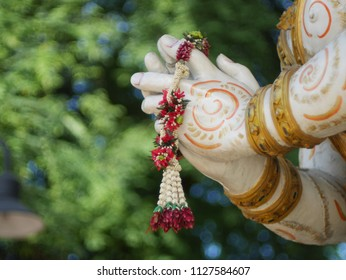hand with thai flower