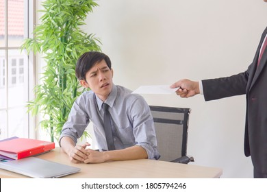 A hand that delivers documents to a grieving Asian man with bad news: A desperate entrepreneur gets laid off, hides crying, disappointed by bankruptcy, business failure, or fired.