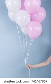 The hand that holds nine balloons