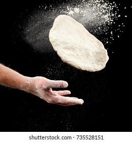 Hand throw a piece of dough