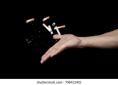 Hand throwing cigarette with motion freeze on black background , no smoke stop quitting sign