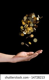 Hand throwing gold coins in the air