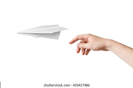 Hand is throwing origami paper airplane. Isolated on white background.